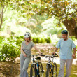 Couple with their bikes in the wood — Foto Stock