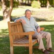 Senior man sitting on a bench — Stock Photo