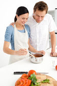 Lovely couple preparing a bolognese sauce together — Stock Photo