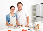 Portrait of a happy couple preparing a bolognese sauce — Stock Photo