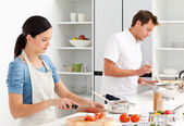 Couple preparing bolognese sauce and pasta together — Stock Photo