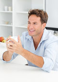 Happy man drinking coffee during a break — Stock Photo