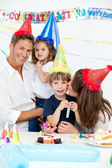 Portrait of a happy family during a birthday party — Stock Photo