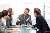 Happy team laughing together at a meeting — Stock Photo