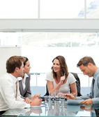Glad businesswoman talking to her team — Stock Photo