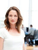 Confident businesswoman standing in front of her team while work — Stock Photo