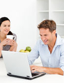 Lovely woman drinking coffee while her husband is working — Stock Photo