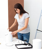Pretty woman preparing white paint to renovate — Stock Photo
