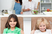 Impatient little brother and sister waiting for their lunch — Stock Photo