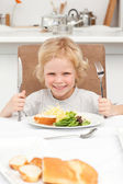 Portrait of a little boy ready to eat pasta and salad — Stock Photo