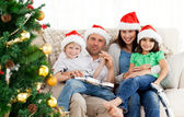 Portrait of a family at Christmas on the sofa — Stock Photo