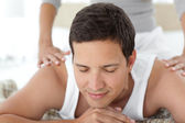 Peaceful being massaged by his girlfriend on their bed — Stock Photo