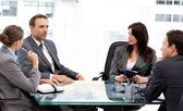 Charismatic businessman talking to his partners during a meeting — Stock Photo
