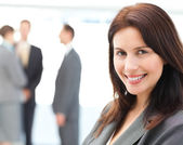 Charismatic businesswoman posing in front of her team — Stock Photo