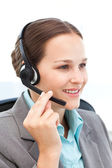 Pretty representative on the phone with earpiece — Stock Photo