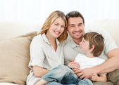 Happy family on their sofa — Stock Photo