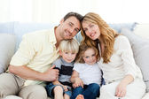 Cute family in their sofa — Stock Photo