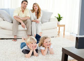 Adorable family watching tv — Stock Photo