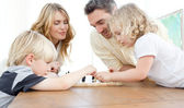 Family playing chess on a table — Stock Photo