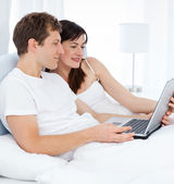 Young pairs watching videos on their computer — Stock Photo
