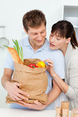 Adorable pairs looking at the shoping bags — Stock Photo