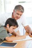 Father helping his son with his homework — Stock Photo