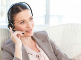 Businesswoman phoning in her living room — Stock Photo