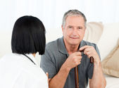 Retired man with his nurse — Stock Photo
