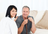 Nurse with her patient looking at the camera — Stock Photo