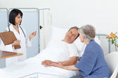 Nurse with a couple in a hospital — Stock Photo