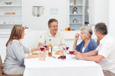 Mature friends taking lunch together — Stock Photo