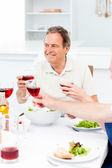 Senior taking lunch with friends — Stock Photo