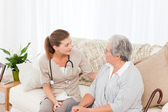 Nurse talking with her patient — Stock Photo