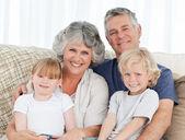 Joyful family looking at the camera — Stock Photo