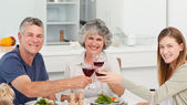 Family drinking wine together — Stock Photo