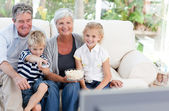 Lovely family watching tv — Stock Photo