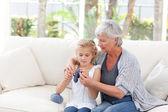 Senior knitting with her granddaughter — Stock Photo