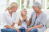 Family knitting together at home — Stock Photo