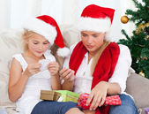 Wonderful woman on christmas day with her daughter — Stock Photo