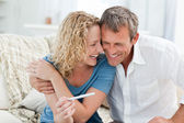 Lovers looking at a pregnancy test — Stock Photo