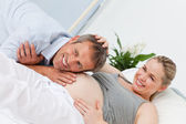 Man listening to his wife's belly — Stock Photo