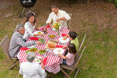 Family eating outside in the garden — Stock Photo