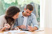 Young couple calculating their domestic bills — 图库照片