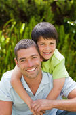 Father with his son hugging in the garden — Stock Photo