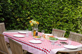 A lunch table in the garden — Stock Photo