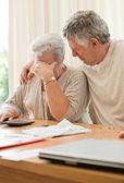 Sad mature couple calculating their domestic bills — Stock Photo