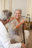 Senior doctor talking with his patient — Stock Photo