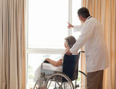 Doctor with his patient looking out the window — Stock Photo