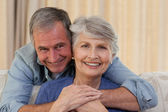 Mature man hugging his wife — Stock Photo