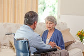 Senior couple talking in the living room at home — Stock Photo
